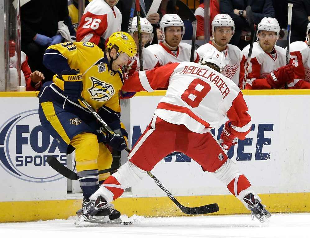 . Nashville Predators center Colin Wilson (33) battles Detroit Red Wings left wing Justin Abdelkader (8) for the puck during the first period of an NHL hockey game Saturday, Dec. 26, 2015, in Nashville, Tenn. (AP Photo/Mark Humphrey)