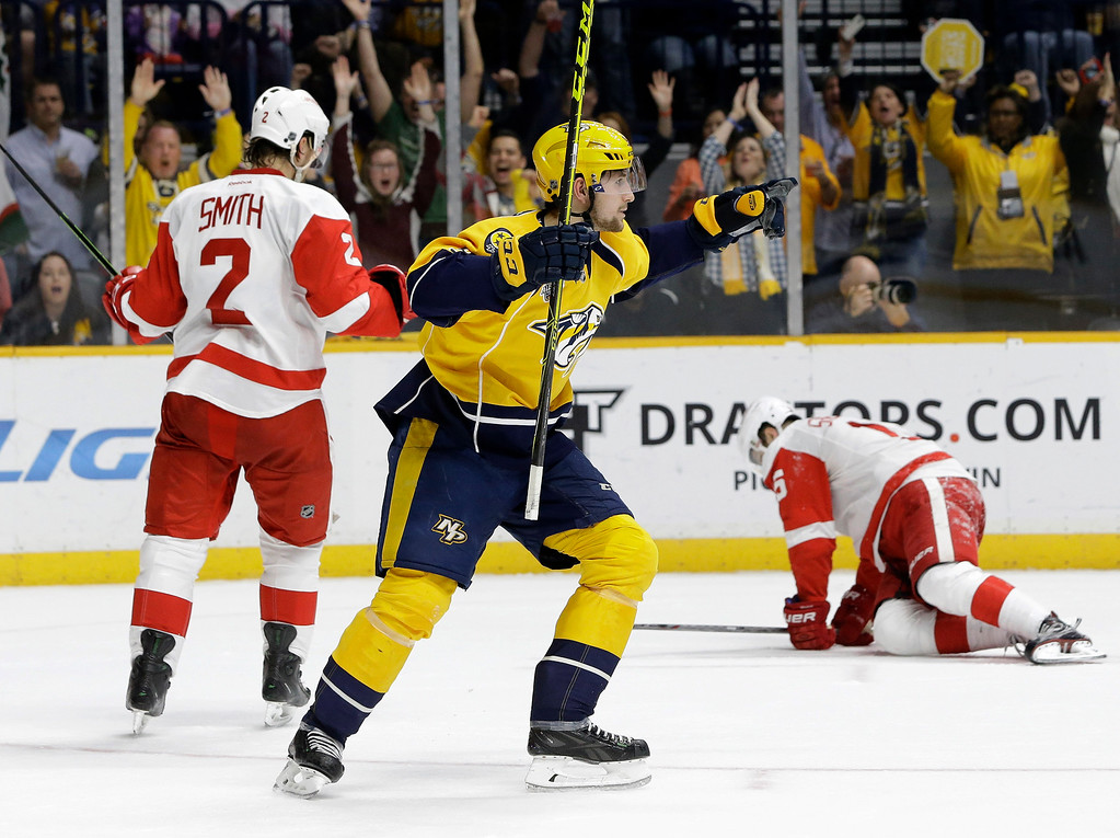 . UPDATES THAT FORSBERG, RATHER THAN CRAIG SMITH, WAS CREDITED WITH THE GOAL - Nashville Predators center Filip Forsberg (9), of Sweden, celebrates a goal against the Detroit Red Wings during the second period of an NHL hockey game Saturday, Dec. 26, 2015, in Nashville, Tenn. On the ice for the Red Wings are Brendan Smith (2) and Riley Sheahan (15). (AP Photo/Mark Humphrey)