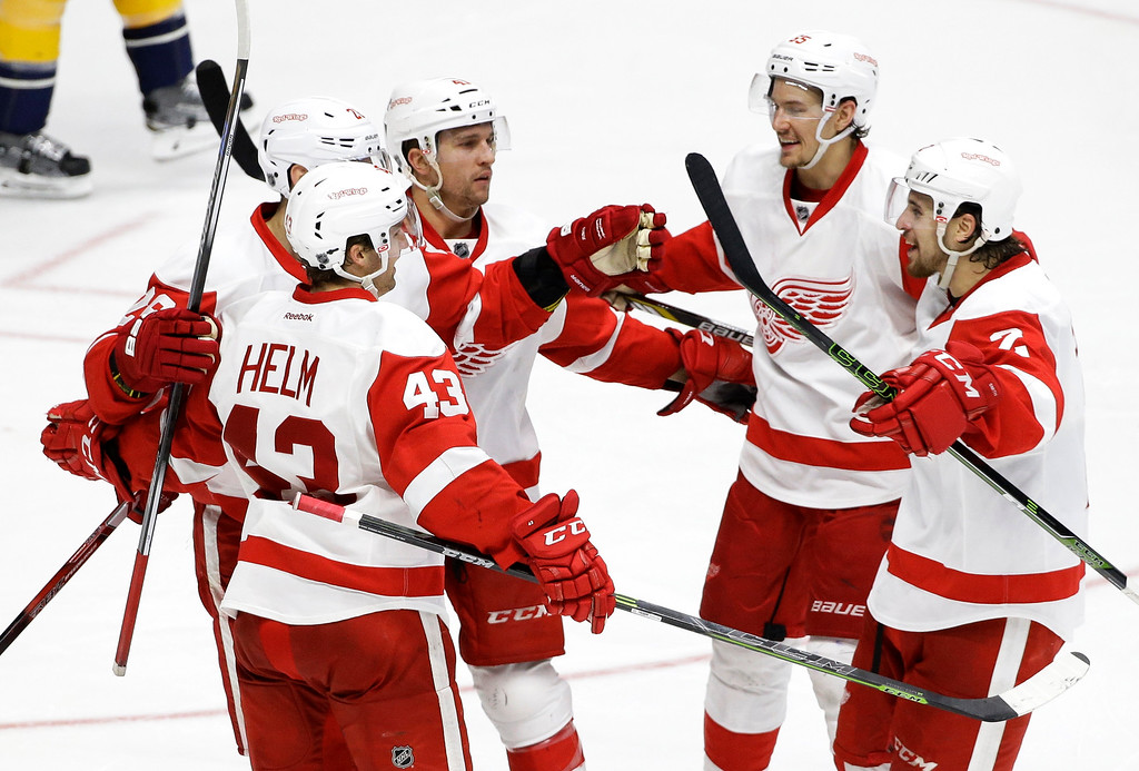 . Detroit Red Wings\' Luke Glendening, center left, celebrates with Darren Helm (43), Danny DeKeyser, second from right, and Brendan Smith (2) after Glendening scored a goal against the Nashville Predators during the third period of an NHL hockey game Saturday, Dec. 26, 2015, in Nashville, Tenn. Detroit won 3-2.. (AP Photo/Mark Humphrey)