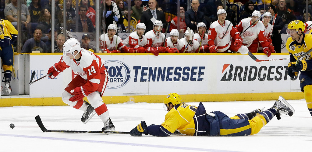 . Nashville Predators defenseman Shea Weber (6) dives to slow down Detroit Red Wings center Gustav Nyquist (14), of Sweden, during the first period of an NHL hockey game Saturday, Dec. 26, 2015, in Nashville, Tenn. (AP Photo/Mark Humphrey)