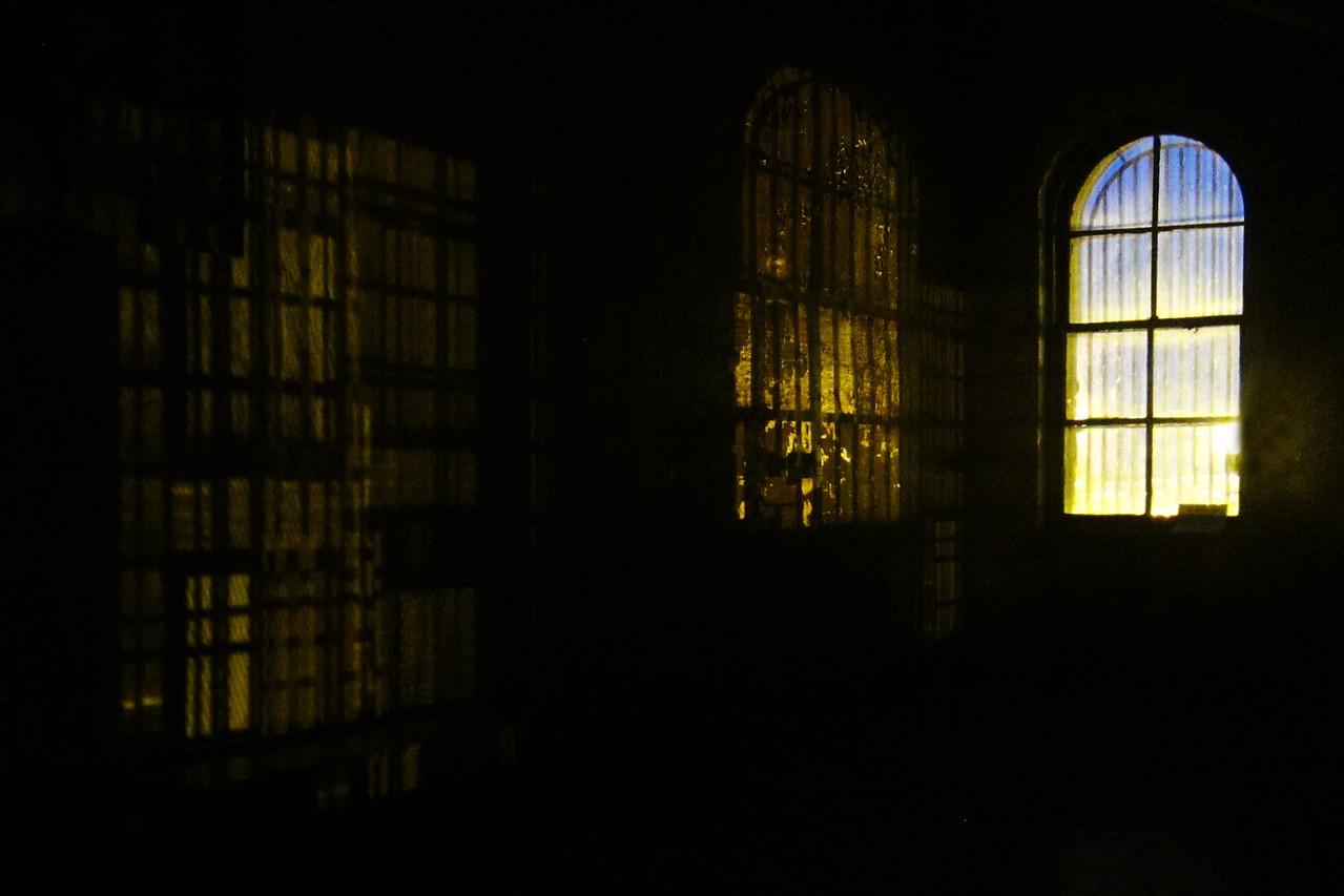 Prison window at night.
