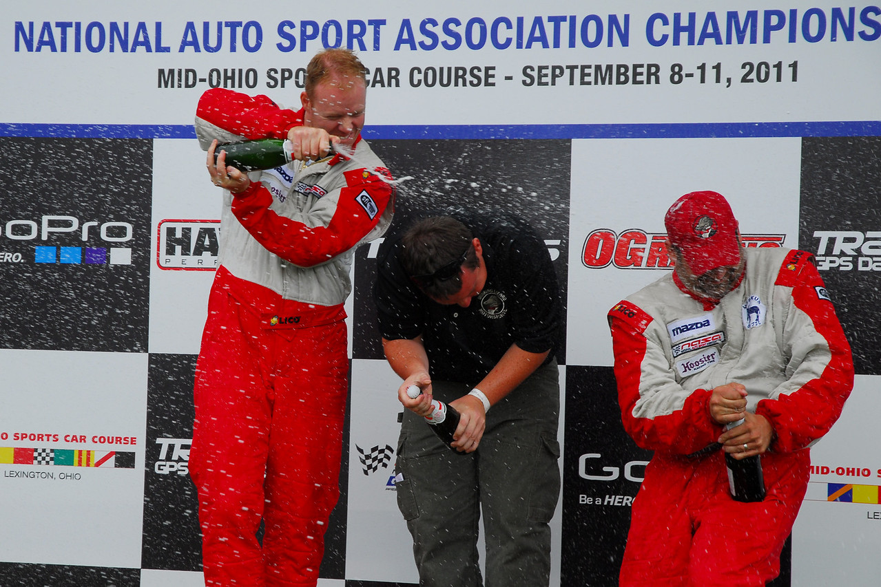Champagne fight #2 - Winking Lizard gang.  As awesome as it was getting on the podium in 2006 it was even better this time around since our entire team made it up there!