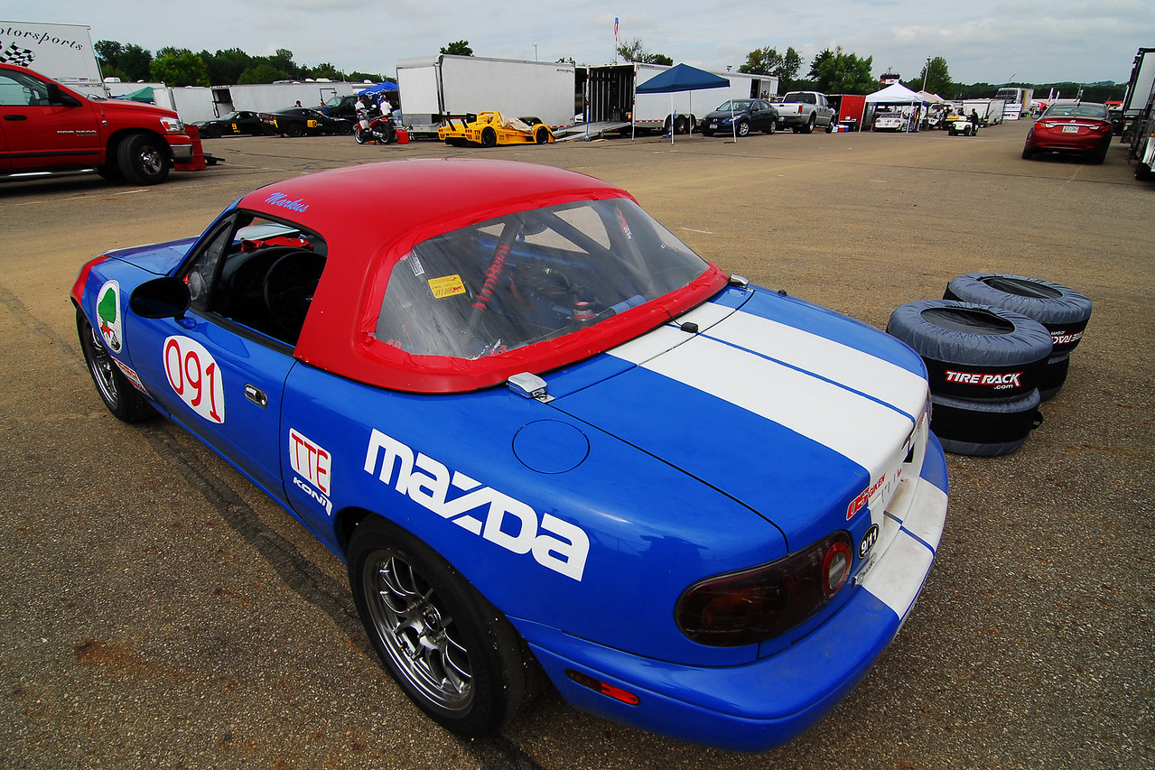 The Miata in my paddock spot.  Note all the large trailers and transporters in the background.  I am on the low budget end of the spectrum for sure.
