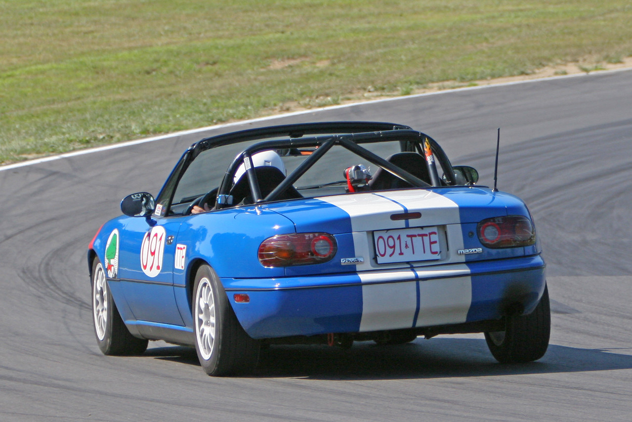 "Lap times dropped dramatically on Sunday for everyone - MidOhio ground down some of the curbing located at midturn, which opened the track up and allowed us to carry much higher speeds.  This is especially important for ""momentum"" cars like Miata's.   Photo credit:  Patrick Strehl."