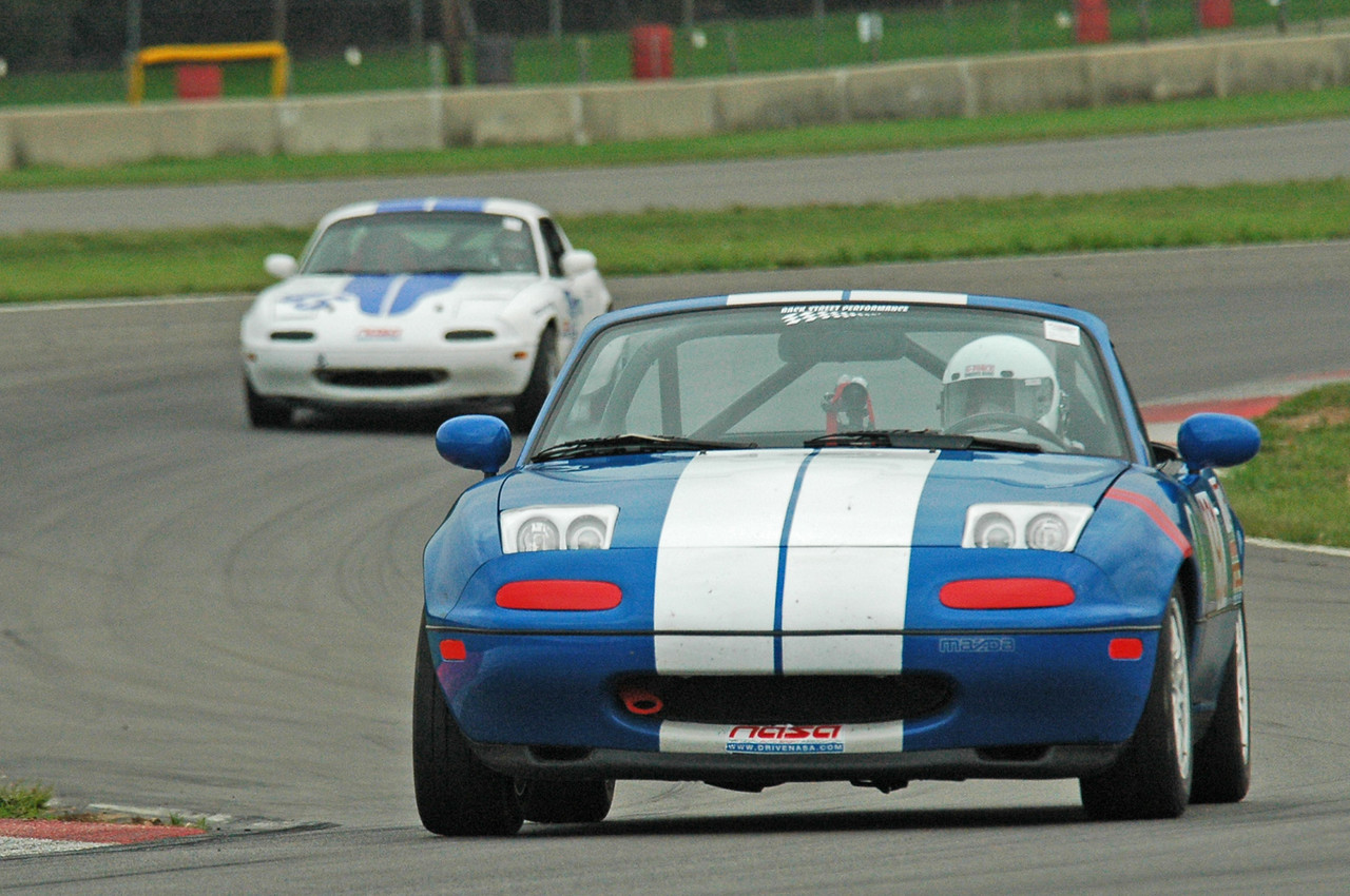 Here I am in the chicane before the keyhole with Dick Stevens chasing me in his Miata.  He didn't catch up.