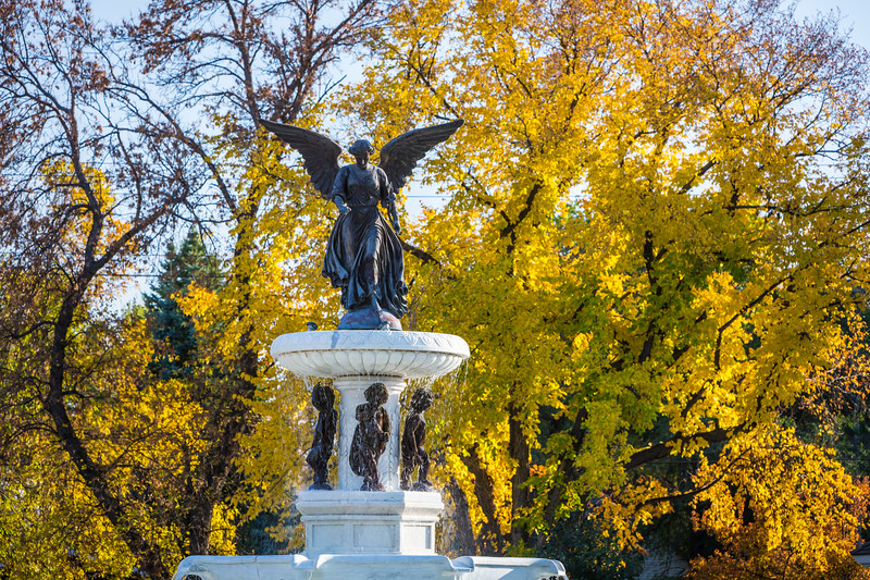 Angel of the Waters decorative fountain with autumn colors in Bethel Heritage Park in Winller, Manitoba, Canada.