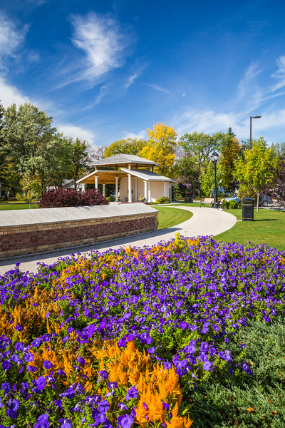 Flower beds and fall foliage color in Bethel Heritage Park in Winkler, Manitoba, Canada.