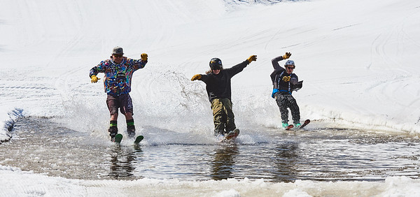 DAVID LIPNOWSKI / WINNIPEG FREE PRESS  (Left to right) Father Dave Parnell, son Rowan Parnell, and Asa France enjoy the last day of downhill skiing and snowboarding at Stony Mountain Ski Area Sunday April 15, 2018.