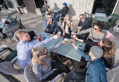 DAVID LIPNOWSKI / WINNIPEG FREE PRESS   Friends enjoy cold beverages on the Bar Italia patio Sunday April 24, 2016.