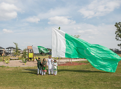 DAVID LIPNOWSKI / WINNIPEG FREE PRESS  (L-R) Son Labeeb, mom Nuzhat Farooqui, daughter Tehreem, and dad Abid Siddiqi pose with Pakistan's flag at Jinnah Park prior to the beginning of festivities celebrating Pakistan's Independence Day and Eid Sunday August 19, 2018.