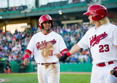 DAVID LIPNOWSKI / WINNIPEG FREE PRESS   Winnipeg Goldeyes Maikol Gonzalez (#3) celebrates his run with teammate Josh Romanski (23) while playing against the Sioux City Explorers at Shaw Park Saturday August 27, 2016.
