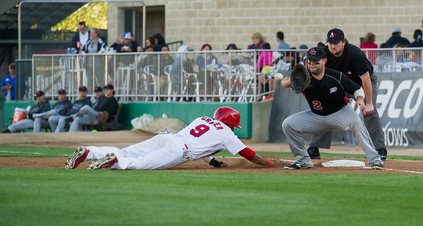 DAVID LIPNOWSKI / WINNIPEG FREE PRESS   Winnipeg Goldeyes Casio Grider (#9) is safe after a pick off attempt while playing against the Sioux City Explorers at Shaw Park Saturday August 27, 2016.