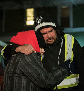 DAVID LIPNOWSKI / WINNIPEG FREE PRESS  (L-R) Aunt and Uncle of Tyler Smoke, Cheryl Paul and Orville Smoke console each other at the vigil for Tyler Smoke in the back alley of Victor Street where he was murdered on Christmas Day, held Thursday December 27, 2018.
