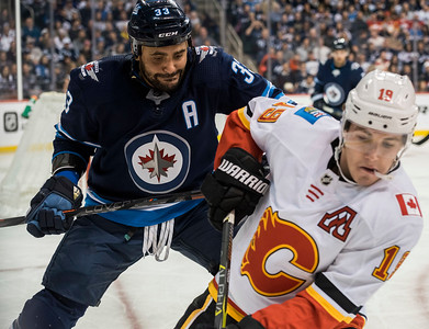 DAVID LIPNOWSKI / WINNIPEG FREE PRESS  Winnipeg Jets #33 Dustin Byfuglien looks approaches Calgary Flames #19 Matthew Tkachuk Thursday December 27, 2018 at Bell MTS Place.