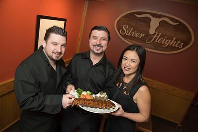 DAVID LIPNOWSKI / WINNIPEG FREE PRESS  (left to right) JC (co-owner), Tony (co-owner), and Sue Siwicki (General Manager) of Silver Heights Restaurant hold a plate of ribs, as the establishment celebrates its 60th anniversary this year. Photographed February 17, 2017.   David Sanderson intersection story