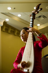 DAVID LIPNOWSKI / WINNIPEG FREE PRESS 160218  Ruyu Zhao of The Guizhou Culture Exchange Performing Arts Troupe plays the Pei Pa at the Best Western Plus Winnipeg Airport Hotel Thursday February 18, 2016.  The media got a sneak peek of the 2016 Chinese New Year Celebration Show (hosted by Manitoba Great Wall Performing Arts) which featured acrobatics, dance and musical performances. The show is on February 20, 2016, 7 PM, at the Pantages Playhouse Theatre.