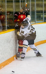 DAVID LIPNOWSKI / WINNIPEG FREE PRESS  University of Manitoba Bisons Jordan Boyd (#22) crashes into University of Calgary Dinos Max Ross #7 Friday February 19, 2016 at Wayne Fleming Arena at Max Bell Centre. This is the first game in the Canada West Quarter Final best-of-three playoff series.