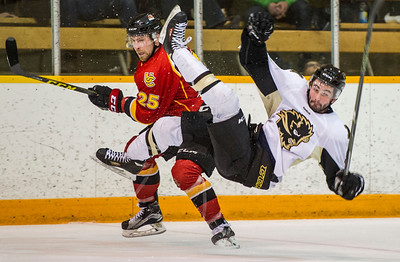 DAVID LIPNOWSKI / WINNIPEG FREE PRESS  University of Manitoba Bisons Liam Bilton (#8) hits the ice as University of Calgary Dinos Kevin King #25 tries to avoid a skate to his face Friday February 19, 2016 at Wayne Fleming Arena at Max Bell Centre. This is the first game in the Canada West Quarter Final best-of-three playoff series.