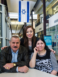 DAVID LIPNOWSKI / WINNIPEG FREE PRESS   Nafiya Naso (centre) with mom Koulan Fandi and dad Enez Jallo at the Rady Jewish Community Centre Wednesday February 24, 2016.  The Yazidi refugees who live on Doncaster across the street from the Rady Centre were afraid to go there because they were raised to be scared of Jews. Now the couple go almost every day to swim and walk laps and the Jewish community is helping to sponsor Yazidi refugees from Iraq and Syria to come to Canada.