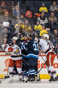 DAVID LIPNOWSKI / WINNIPEG FREE PRESS  Manitoba Moose and Grand Rapids Griffins fight during second period action at Bell MTS Place Wednesday January 10, 2018.