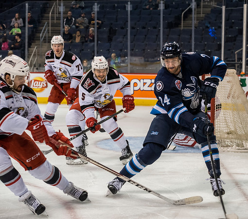 DAVID LIPNOWSKI / WINNIPEG FREE PRESS  Manitoba Moose Cam Maclise (#24) jostles for the puck against the Grand Rapids Griffins during second period action at Bell MTS Place Wednesday January 10, 2018.
