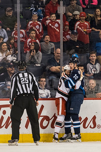 DAVID LIPNOWSKI / WINNIPEG FREE PRESS  Manitoba Moose Buddy Robinson (#10) fight hugs with Grand Rapids Griffins Dominik Shine (#65) during first period action at Bell MTS Place Wednesday January 10, 2018.