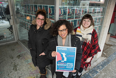 DAVID LIPNOWSKI / WINNIPEG FREE PRESS   (from left to right) Jen Glenwright of IRCOM, Alexa Potashnik of Black Space Winnipeg, and MC of Woman's March on Washington -Winnipeg, and Lauren Checkley of Rainbow Resource Centre are involved in the march taking place in Winnipeg in solidarity with the Women's March on Washington pose for a photo January 17, 2017.