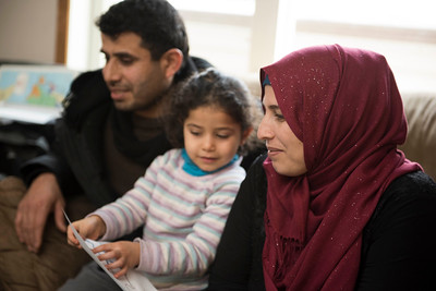 DAVID LIPNOWSKI / WINNIPEG FREE PRESS   From left: Kamal Alhassan, his daughter Rimus and his wife, Amouna Alhassan gather at the home of Fadel and Rania Ahmad for conversational English classes twice a week January 17, 2017. The refugees from Syria arrived in Canada last February.