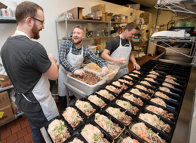 DAVID LIPNOWSKI / WINNIPEG FREE PRESS   (Left to right) Prairie Box co-owners Lewis Glassey, Brandon Schofield and sous-chef Jon Rosnoski prepare this week's meals in the kitchen of Fionn MacCool's Sunday January 22, 2017. Prairie Box is Winnipeg's first subscription, restaurant-style meal delivery service.