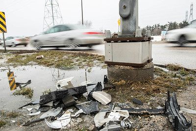 DAVID LIPNOWSKI / WINNIPEG FREE PRESS   Car parts on the side of the road as Wise Up Winnipeg brings attention to Bishop Grandin Blvd & St Mary's Rd intersection Sunday January 22, 2017.