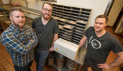 DAVID LIPNOWSKI / WINNIPEG FREE PRESS   (Left to right) Prairie Box co-owners Brandon Schofield, Lewis Glassey and sous-chef Jon Rosnoski prepare this week's meals in the kitchen of Fionn MacCool's Sunday January 22, 2017. Prairie Box is Winnipeg's first subscription, restaurant-style meal delivery service.