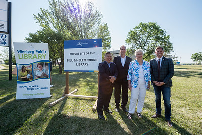 DAVID LIPNOWSKI / WINNIPEG FREE PRESS  A sign is unveiled during the official unveiling of the location of the future River Heights Library, renamed the Bill & Helen Norrie Library Friday July 13, 2018.