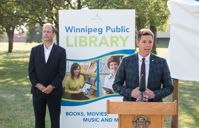 DAVID LIPNOWSKI / WINNIPEG FREE PRESS  Mayor Brian Bowman (right) speaks as Councillor John Orlikow, River Heights-Fort Garry Ward listens during the official unveiling of the location of the future River Heights Library, renamed the Bill & Helen Norrie Library Friday July 13, 2018.
