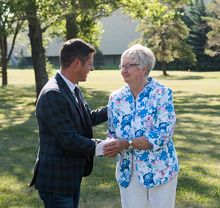 DAVID LIPNOWSKI / WINNIPEG FREE PRESS  Mayor Brian Bowman embraces Helen Norrie during the official unveiling of the location of the future River Heights Library, renamed the Bill & Helen Norrie Library Friday July 13, 2018.