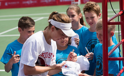 DAVID LIPNOWSKI / WINNIPEG FREE PRESS  Francesca Di Lorenzo of USA signs autographs for ball boys and girls after defeating Erin Routliffe of Canada for the women's singles title at the National Bank Challenger Tennis Tournament at Winnipeg Lawn Tennis Club Sunday July 17, 2016.