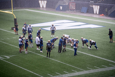 DAVID LIPNOWSKI / WINNIPEG FREE PRESS   Winnipeg Blue Bombers practice in the rain at Investors Group Field Friday Sunday July 17, 2016.