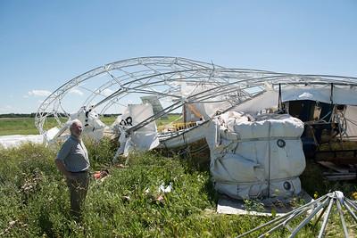 DAVID LIPNOWSKI / WINNIPEG FREE PRESS  President of Buoyant Aircraft Systems International Barry E. Prentice surveys damage to a hangar and two airships at St. Andrews airport Thursday July 21, 2016.