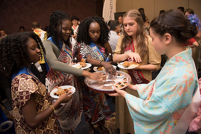 DAVID LIPNOWSKI / WINNIPEG FREE PRESS  (L-R) South Sudanese pavilion ambassadors: Rita Kaka , Anak Akeen, Adut Ayob, French Canadian pavilion ambassador Karine Jubinville sample SPAM Musubi from Japanese Pavillion Ambassador Seika Dyck at a Folklorama media call at the RBC Convention Centre Thursday July 21, 2016.