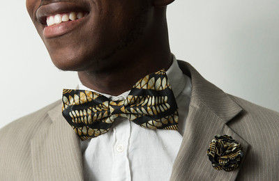 DAVID LIPNOWSKI / WINNIPEG FREE PRESS   Co-founder of  Lula Nga, Kenan Kamanga, poses for photographs Wednesday July 5, 2017.  They run a local business that specializes in one-of-a-kind bowties, pocket squares and flower pins that reflect the culture of Guylain's home country, Congo.