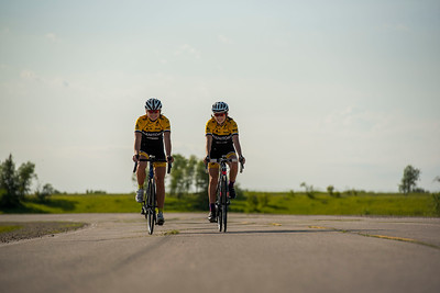 DAVID LIPNOWSKI / WINNIPEG FREE PRESS  Chloe Penner (left) and Rebecca Man (right) are both local cyclists competing in the Canada Games this summer in Winnipeg. They pose for a photo prior to the Grand Pointe Road Race in Grand Pointe, Manitoba Wednesday July 5, 2017.