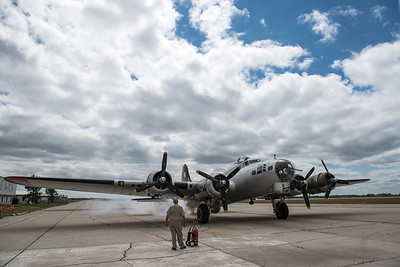 DAVID LIPNOWSKI / WINNIPEG FREE PRESS  Crew Chief Craig Bartscht from Fort Wayne , Indiana checks over the engines of a Boeing B-17 Bomber (Flying Fortress) prior to takeoff from the Gimli Airport Wednesday July 6, 2016. The World War 2 era plane is one of only 13 aircraft of its type still flying.