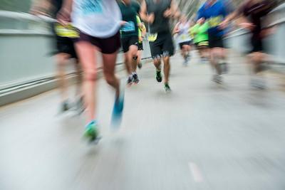 DAVID LIPNOWSKI / WINNIPEG FREE PRESS  Half Marathon participants run over the Elm Park Bridge Sunday June 18, 2017.