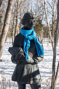 "DAVID LIPNOWSKI / WINNIPEG FREE PRESS  Even the sculptures need to bundle up, including ""School Girl"" Friday March10, 2017 at the Leo Mol Sculpture Garden at Assiniboine Park"