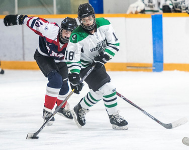 DAVID LIPNOWSKI / WINNIPEG FREE PRESS  Vincent Massey Trojans  #18 Genevieve Houghton fights for the puck against St. Mary's Flames #10 Chloe Kreitz during the Women's High school hockey A division semi finals at Sam Southern Arena Thursday March 2, 2017. The Vincent Massey Trojans  advance to final against the Shaftesbury Titans.