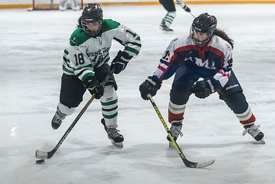 DAVID LIPNOWSKI / WINNIPEG FREE PRESS  Vincent Massey Trojans  #18 Genevieve Houghton fights for the puck against St. Mary's Flames #12 Ally Rakowski during the Women's High school hockey A division semi finals at Sam Southern Arena Thursday March 2, 2017. The Vincent Massey Trojans  advance to final against the Shaftesbury Titans.