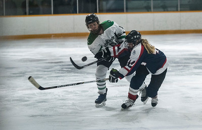 DAVID LIPNOWSKI / WINNIPEG FREE PRESS  Vincent Massey Trojans  #15 Robin Maslyk shoots the puck past St. Mary's Flames #44 Sierra Sutherland during the Women's High school hockey A division semi finals at Sam Southern Arena Thursday March 2, 2017. The Vincent Massey Trojans  advance to final against the Shaftesbury Titans.