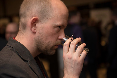 DAVID LIPNOWSKI / WINNIPEG FREE PRESS  Winnipeg Free Press wine writer Ben MacPhee-Sigurdson takes in the 2017 Winnipeg Whiskey Festival Friday March 3, 2017 at the Fairmont Hotel.