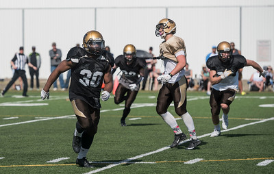 DAVID LIPNOWSKI / WINNIPEG FREE PRESS  University of Manitoba Bisons linebacker Bami Adewale (#30) during the University of Manitoba Bisons 2016 spring camp Sunday May 1, 2016 at the University of Manitoba Turf Fields.
