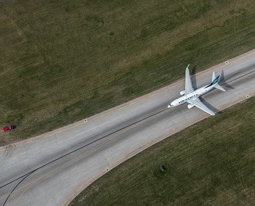 DAVID LIPNOWSKI / WINNIPEG FREE PRESS  Westjet Airplane at Winnipeg James Armstrong Richardson International Airport  Aerial photography over Winnipeg May 18, 2016 shot from STARS helicopter.