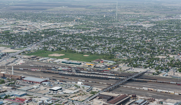 DAVID LIPNOWSKI / WINNIPEG FREE PRESS  Arlington Bridge dividing North/South Winnipeg  Aerial photography over Winnipeg May 18, 2016 shot from STARS helicopter.